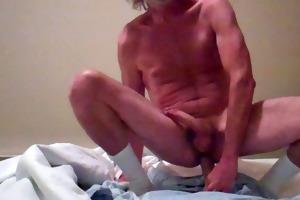 dad rides his fat dildo and cums