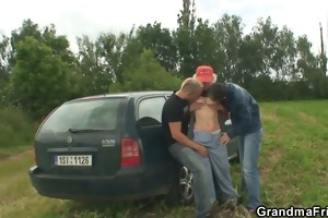 old bitch enjoys threesome in the fields