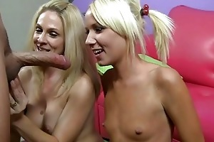 hot mama and her daughter engulfing the same knob
