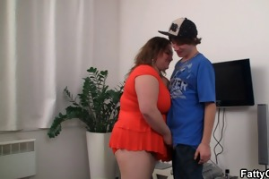 chubby whore sucks and rides his young cock