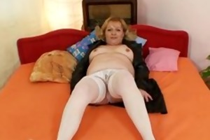 lewd aged lady wears stockings and toys herself