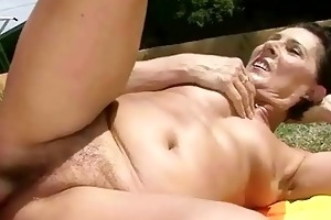youthful man bonks sexy granny outdoor