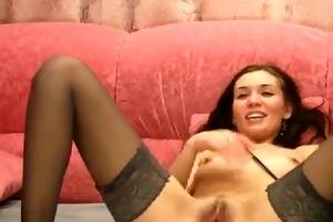 brunette in darksome stockings dildos her pussy
