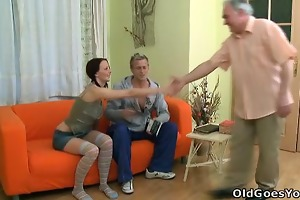young babe screams out as an old fellow gives her