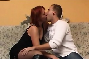red-haired and aged mamma warms up a young man