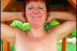 granny is fucking a youthful dude in the garden