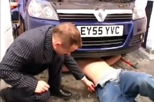young car mechanic servicing older gay businessman