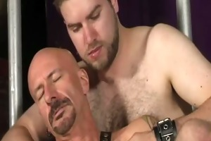 leather daddy jerking off in lads embrace