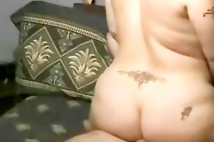 bulky tramp stamp milf rides cock until she is