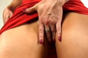 hard muscles and a large clit in a hawt red dress