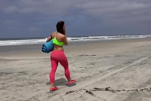 fitness pro does s garb yoga on beach