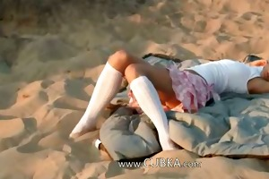 miniature 18 years old chick loly on beach