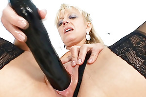 old golden-haired milf stuffing pussy with huge