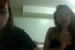2 sexy wasted young oriental girls shaking their