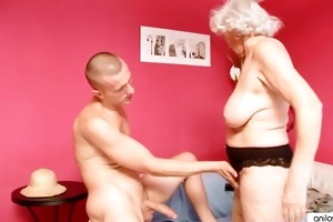 mature granny betty copulates youthful cock